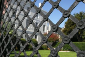 An image of iron gates, used here to symbolise Umbrella Security's security guards services