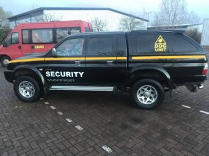 An image of a mobile security van on a business site used by Umbrella Security Services.