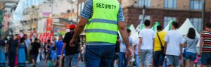 An image of a security guard, wearing a uniform.