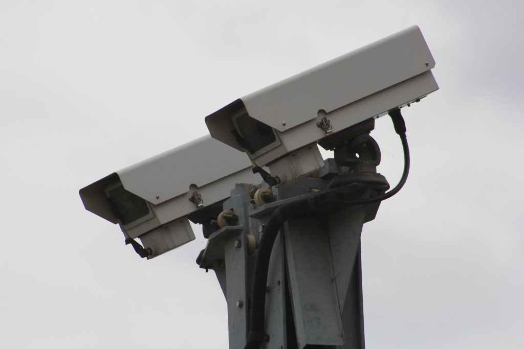 An image of two security cameras that have been installed by Umbrella Security Services.