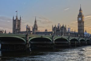 An image of Big Ben and the London Bridge, over the Thames.