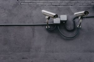 image of cctv security cameras attached to the side of a wall