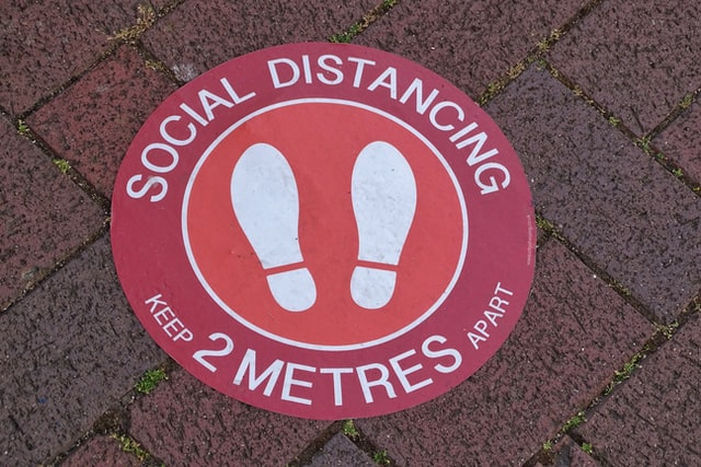 image of social distancing 2 metres ground signage